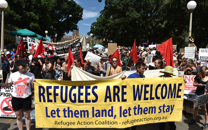 Protestors march on the streets of Sydney's central business district against US President Donald Trump's travel ban policy on 4 February, 2017. Picture: AFP