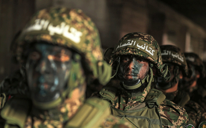 Hamas militants take part in a rally marking the 30th anniversary of the founding of the Islamist movement, in Gaza City, on 14 December 2017. Picture: AFP