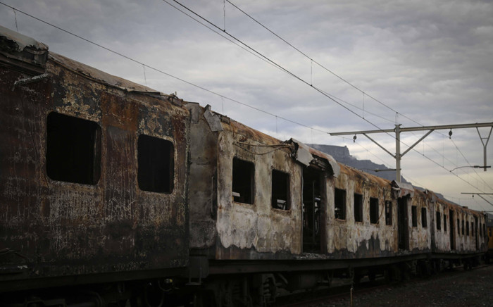 Five carriages caught alight at Retreat station on 27 July 2018. Picture: Cindy Archillies/EWN.