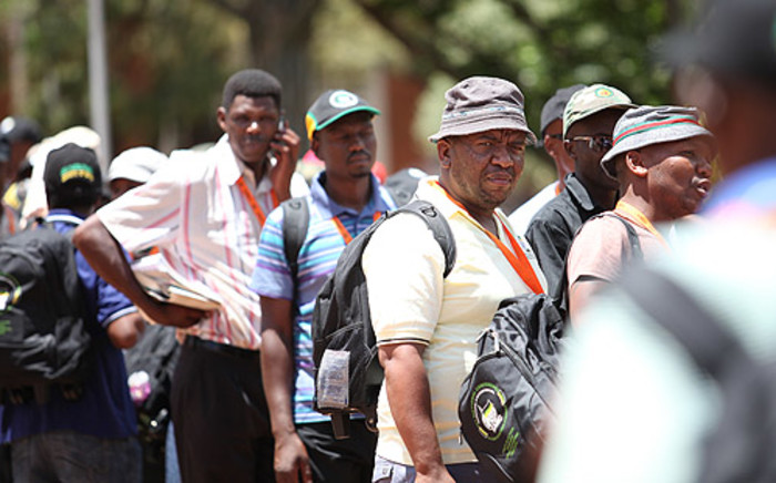 ANC delegates queue in Mangaung on 19 December 2012 to vote in new members of the NEC. Picture: Taurai Maduna/EWN.