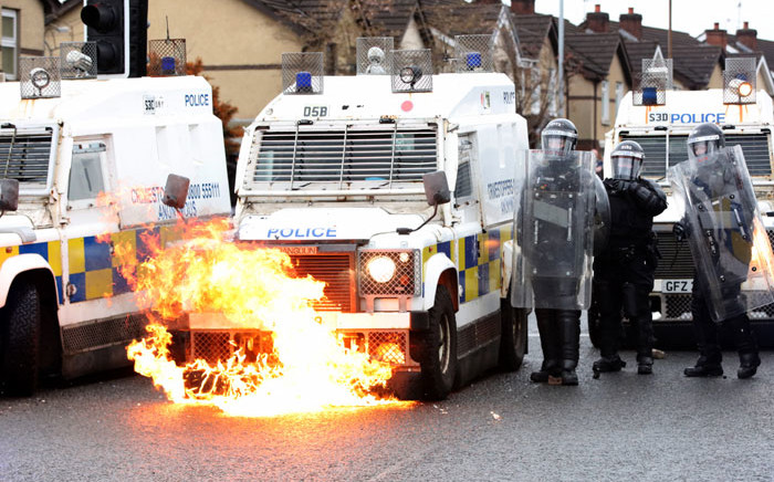 Flames lick up the front of a police vehicle as police officers are attacked by nationalist youths in the Springfield Road area of Belfast on April 8, 2021 following days of loyalist violence. Picture: Paul Faith/AFP