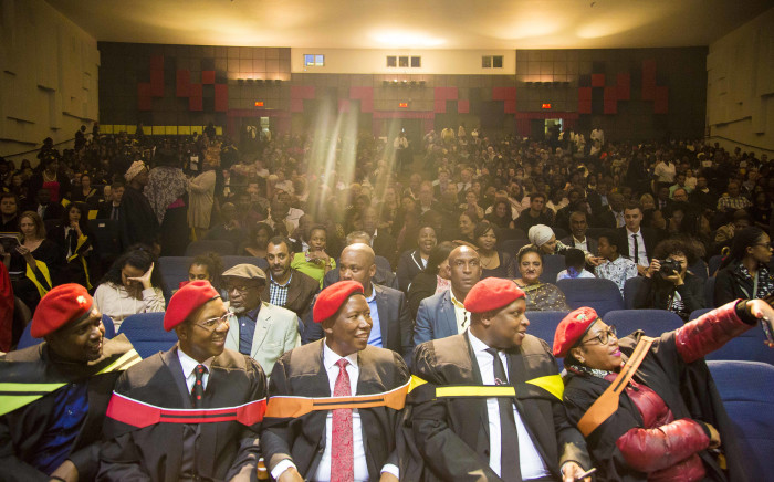 Members of the EFF, here to support their colleague Mbuyiseni Ndlozi's graduation at Wits University, sit during the last two verses of the National Anthem. Picture: Thomas Holder/EWN