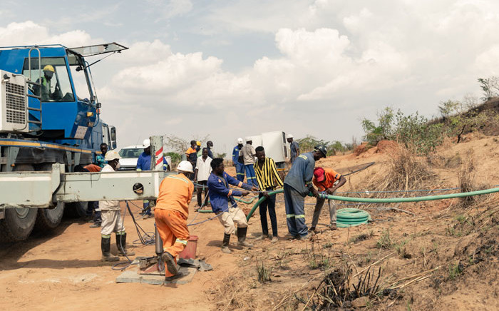 Rescue workers busy at work installing a water pump to drain water from a mine shaft so that they can gain access to at least 40 informal gold miners trapped inside a collapsed shaft at Ran Mine in Bindura, on 26 November 2020. Picture: AFP
