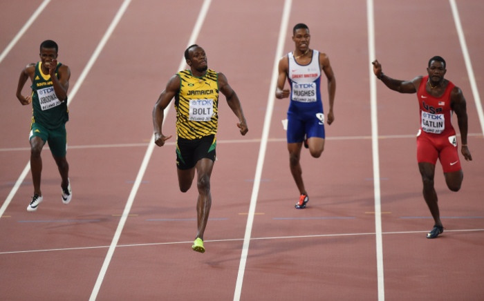 South Africa's Anaso Jobodwana, Jamaica's Usain Bolt, Britain's Zharnel Hughes and the US's Justin Gatlin compete in the final of the men's 200m athletics event at the 2015 IAAF World Championships in Beijing on 27 August 2015. Picture: AFP.