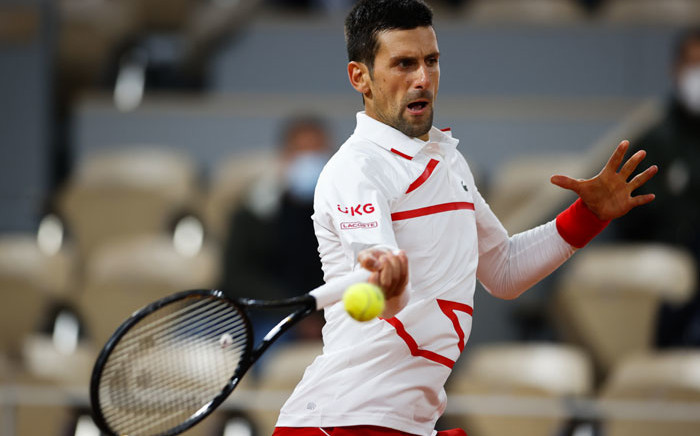 Serbia's Novak Djokovic returns the ball to Sweden's Mikael Ymer during their men's singles first round tennis match at the Philippe Chatrier court on Day 3 of The Roland Garros 2020 French Open tennis tournament in Paris on 29 September 2020. Picture: AFP