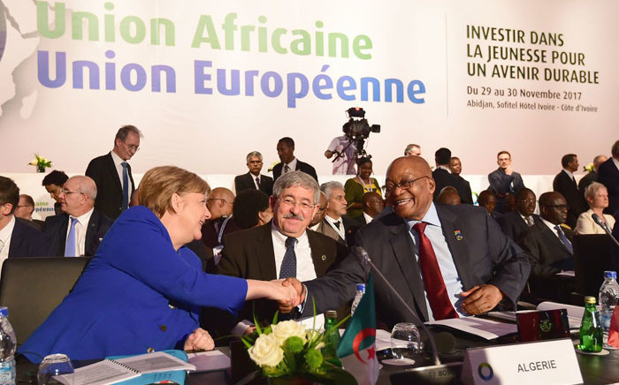 German Chancellor Angela Merkel (left) shake hands with South Africa's President Jacob Zuma (right) while the Prime of Minister of Algeria, Abdelmalek Sellal, looks on at the Fifth African Union-European Union Summit which is taking place in Abidjan, the Republic of Cote D'Ivoire. Picture: GCIS