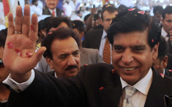 Pakistan's new Prime Minister Raja Pervez Ashraf gestures as he arrives at the coalition party headquarters of MQM in Karachi. Picture: AFP