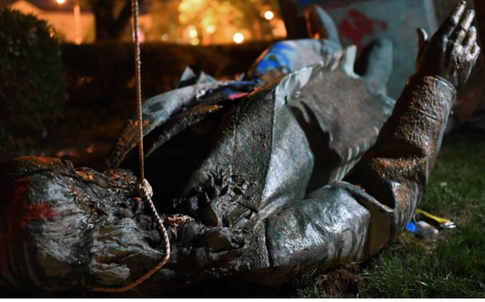 The statue of Confederate general Albert Pike is pictured after it was toppled by protesters at Judiciary square in Wahsington, DC on late 19 June 2020. Protesters have toppled the only statue of a Confederate general in the US capital, images broadcast by US media show. Picture: AFP