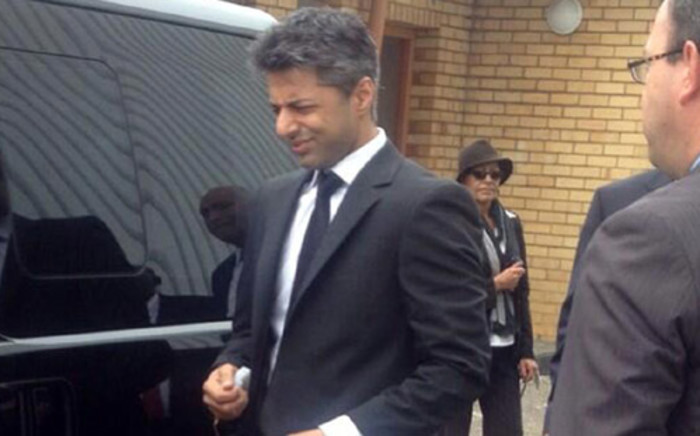 Murder accused Shrien Dewani arrived in Cape Town on 8 April 2014. Picture: Sapa.