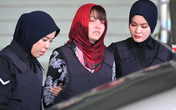 Vietnamese national, Doan Thi Huong (C) leaves Shah Alam High Court escorted by Malaysian police, outside Kuala Lumpur on 14 March 2019. Picture: AFP
