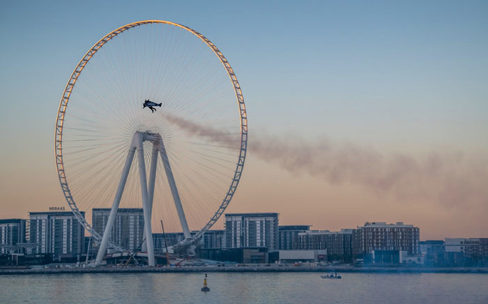 A handout picture released by the Expo 2020 on 17 February 2020, shows Vince Reffet, known as Jetman, taking part in a flight in the Emirati city of Dubai. Picture: AFP