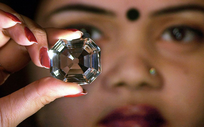 An Indian model shows the replica of the famous Indian diamond Koh-i-noor. Picture: AFP.
