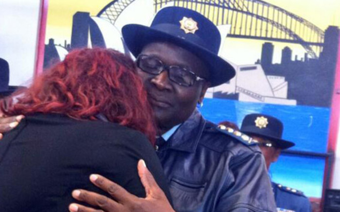 National Police Commissioner Riah Phiyega comforts the slain officer's widow during his memorial service on 23 April 2014. Picture: Mia Spies/EWN.
