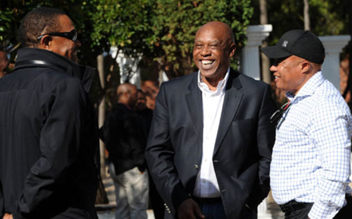 Human Settlements Minister Tokyo Sexwale jokes with other ANC members. Picture: SAPA