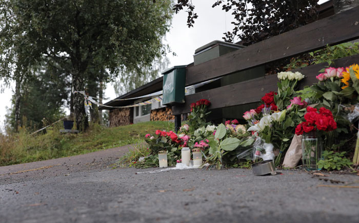 Flowers lay outside the home of 17-year-old stepsister of suspected Mosque attacker in Baerum near Oslo, Norway, on 12 August 2019. Picture: AFP
