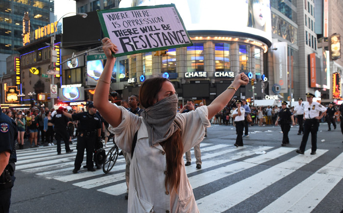 Demonstators rally in the middle of Times Square after they march through the city and call for justice for Alton Sterling and Philandro Castile on 7 July, 2016 in New York. Picture: AFP.