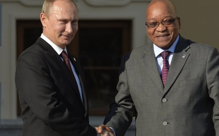 FILE: Russian President Vladimir Putin welcomes President Jacob Zuma at the start of the G20 summit on 5 September 2013, Saint Petersburg, Russia. Picture: AFP
