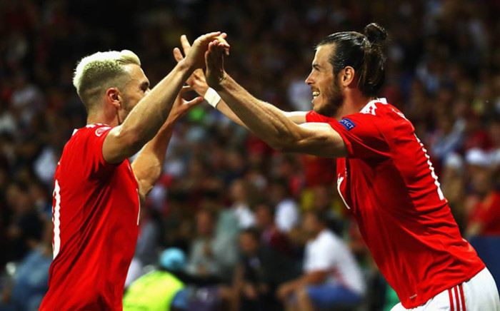 Wales' Aaron Ramsey and Gareth Bale celebrate after their win the in last match of Group B of the Uefa Euro 2016 on 20 June 2016. Picture: UEFA Euro 2016 official Facebook page.