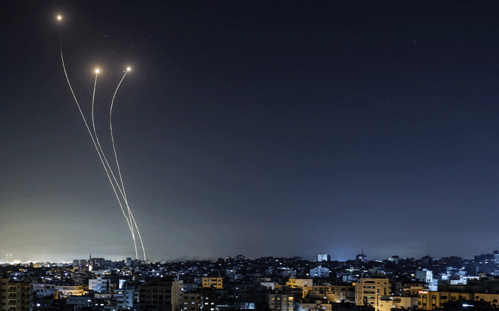 A streak of light appears as Israel's Iron Dome anti-missile system intercepts rockets launched from the Gaza Strip, early on May 17, 2021, Israeli warplanes bombarded the Gaza Strip overnight, said witnesses in the Palestinian enclave, from where armed groups have launched rockets into the Jewish state. Picture: Mahmud Hams / AFP