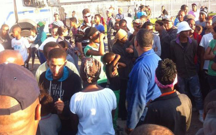 Hundreds of disgruntled Macassar residents gathered near the police station threatening to vandalise more public property. Picture: Mia Spies