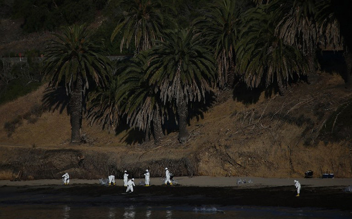 Jerry Brown declared a State of Emergency after over 100,000 gallons of oil spilled from an abandoned pipeline on the land near Refugio State Beach, spreading over about nine miles of beach within hours. Picture: AFP.