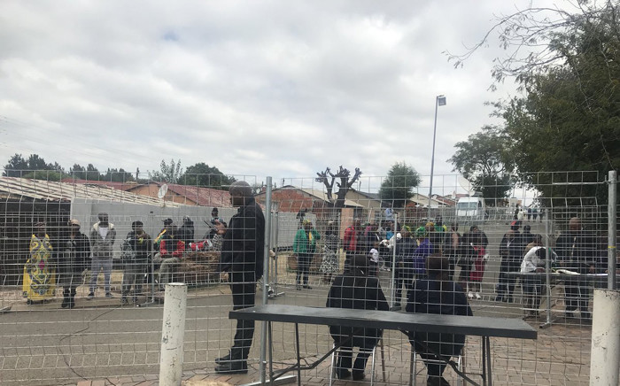 People gather around Winnie Madikizela-Mandela's home on Friday 13 April ahead of a guard of honour scheduled to collide with the delivery of her body to her home. Picture: Clement Manyathela/EWN