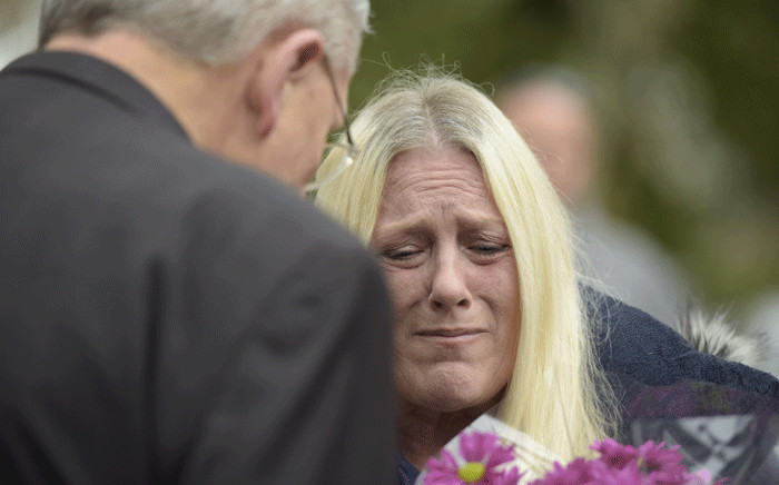 Denise Fulton, who lives outside of Pittsburgh, cries as she speaks with Bishop David Zubik after she came to show support for members of the community near the Tree of Life Synagogue, after a gunman opened fire inside, at Squirrel Hill, Pennsylvania on 27 October 2018. Picture: AFP.