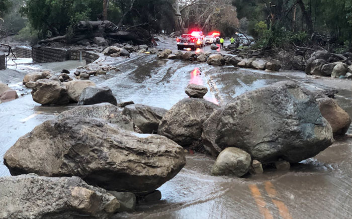 Rocks block the Hot Springs Road in Montecito following debris and mud flow due to heavy rain falls in Montecito, California, on 9 January, 2018. Picture: AFP