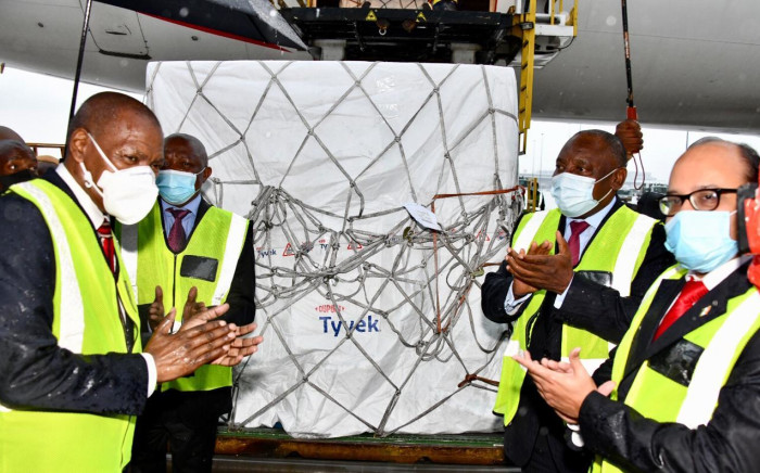 Health Minister Zweli Mkhize, Deputy President David Mabuza, President Cyril Ramaphosa and Deputy High Commissioner of India Abhijit Chakraborty celebrate the arrival of the first million doses of the AstraZeneca COVID-19 vaccine at OR Tambo International Airport on 1 February 2021. Picture: GCIS.