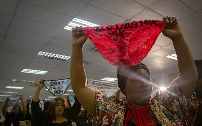 FILE: Women activists hold up underwear at the gender-based violence summit during President Cyril Ramaphosa's speech. Picture: Sethembiso Zulu/EWN