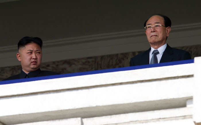 FILE: North Korean leader Kim Jong-Un (left) looks at President of the Presidium of the Supreme People's Assembly of North Korea Kim Yong Nam during a military parade in April 2012. Picture: AFP.