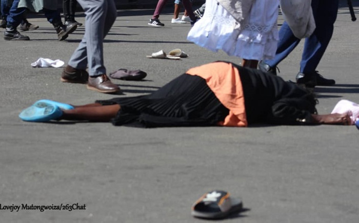 A woman lies unconscious on the street during protests in Harare, Zimbabwe on 16 August 2019. Picture: Lovejoy Mutongwiza/@263Chat/Twitter/Supplied