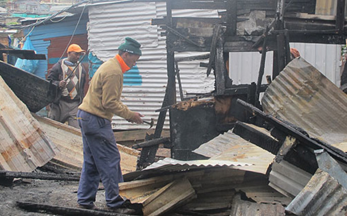 Two children, aged seven and five, that died in a shack fire had been left in the care of a 10-year-old.