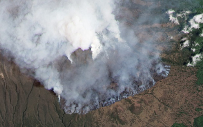 This hand out satellite image courtesy of Planet Lab, Inc taken on 12 October 2020, shows a fire on the slopes of Africa's highest mountain Kilimanjaro. Picture: AFP.