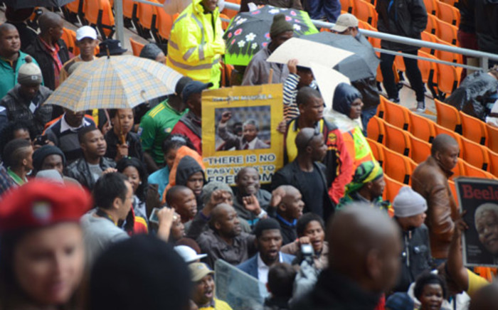 People have already started to pack the FNB Stadium ahead of Nelson Mandela's memorial service, which is expected to be one of the biggest gatherings of world leaders in history. Picture: Christa Van der Walt/EWN.