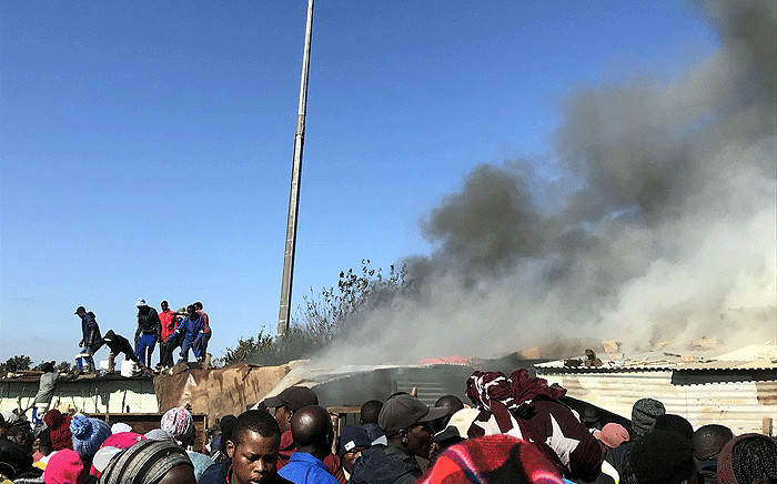 Tswelopele residents seen at the site of a shack fire on 18 May 2018. Picture: Clement Manyathela/EWN