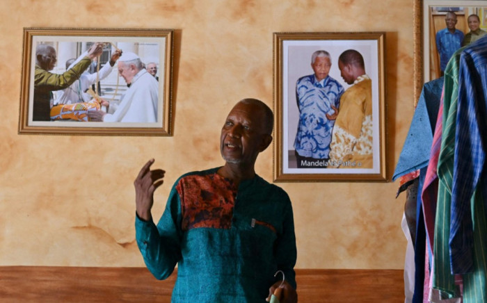 """Ivorion-Burkinabè fashion designer Pathé Ouedraogo in his store in Abidjan on 26 May 2021. A small self-taught tailor in his early years, the Ivorian-Burkinabe Pathe'O became the designer of African heads of state and celebrates the 50th anniversary of his brand, leading the """"fight"""" for the recognition of fashion on the continent. Picture: Issouf Sanogo/AFP"""