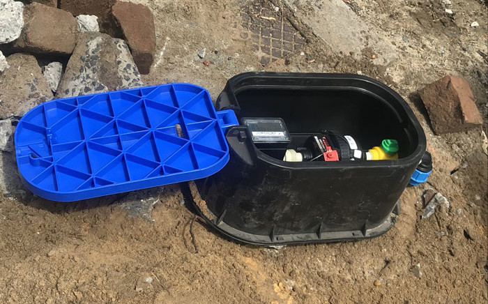 The City of Cape Town's Water Inspectorate install a water saving device at a property in Cape Town on 3 December 2017. Picture: Kevin Brandt/EWN