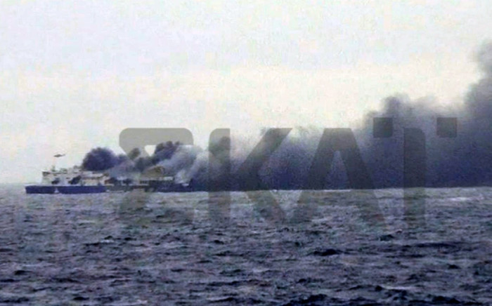 A photo grabbed from the Greek television channel Skai shows the burning ferry the Norman Atlantic sailing on the Adriatic sea on December 28, 2014. Picture: AFP/SKAI TV.