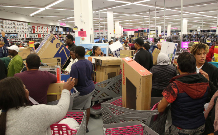Hundreds of shoppers rush to the tech section in Game Canal Walk on 23 November 2018 for Black Friday deals. Picture: Bertram Malgas/EWN
