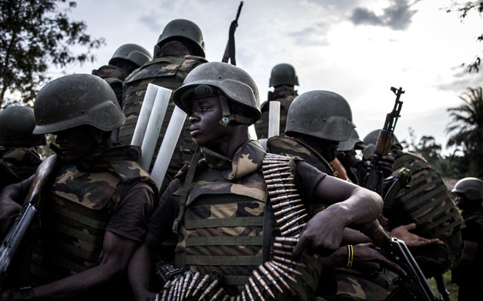Soldiers from the Armed Forces of the Democratic republic of the Congo (FARDC) are seen gearing up as gunfire erupts close by on 7 October 2018 outside Oicha. Attacks on FARDC bases by the ADF has become more common. The ADF usually attack at night over the weekends, in search of arms, ammunition and medical supplies. Picture: AFP