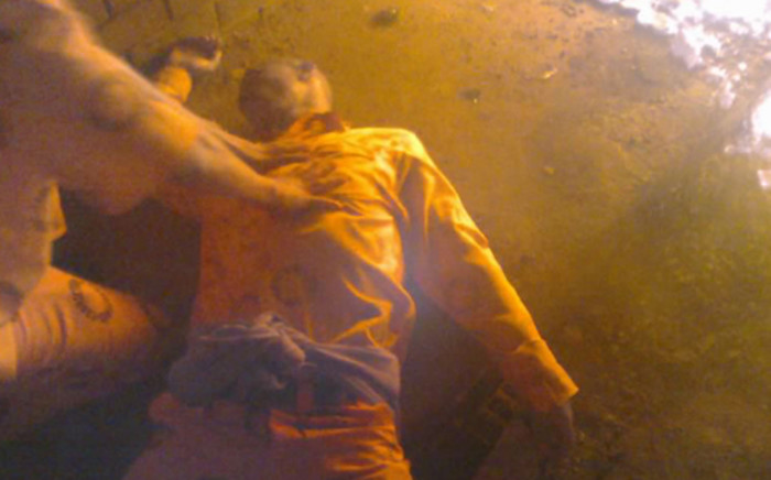 An inmate at the Groenpunt Prison in Deneysville in the Free State appears to suffer from smoke inhalation after part of the facility was set on fire on 7 January, 2013. Picture: Supplied