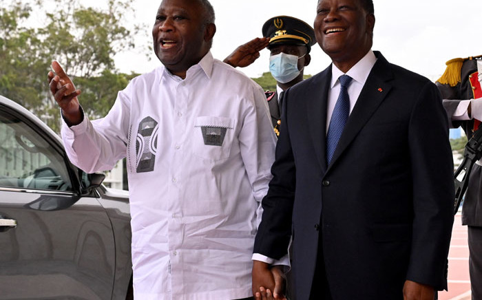 Ivory Coast President Alassane Ouattara (R) welcomes his predecessor and former rival Laurent Gbagbo (L) at the presidential palace in Abidjan, on 27 July2021 for their first talks since Gbagbo returned last month from Europe after a nearly 10-year absence. Picture: ISSOUF SANOGO/AFP