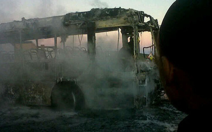 Port Elizabeth residents allegedly torched foreign-owned shops and a bus on 30 May 2013. Picture: Siyabonga Sesant/EWN