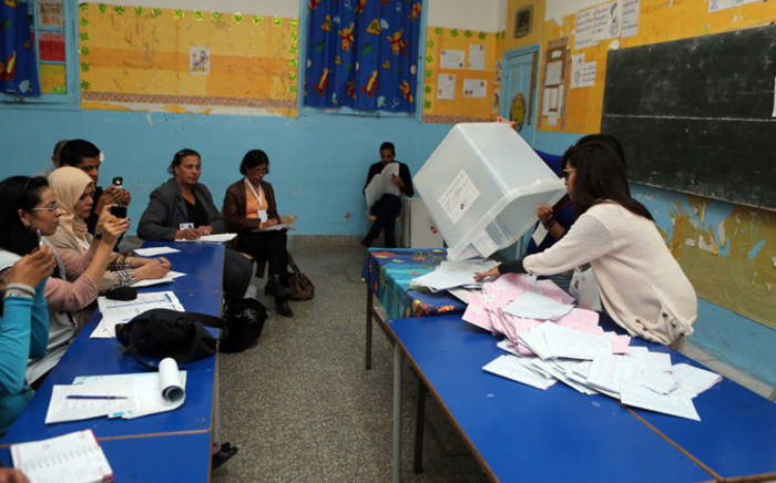 FILE: Tunisians count ballots after the polls closed in the presidential elections at a polling station in Tunis on 23 November 2014. Picture: EPA.