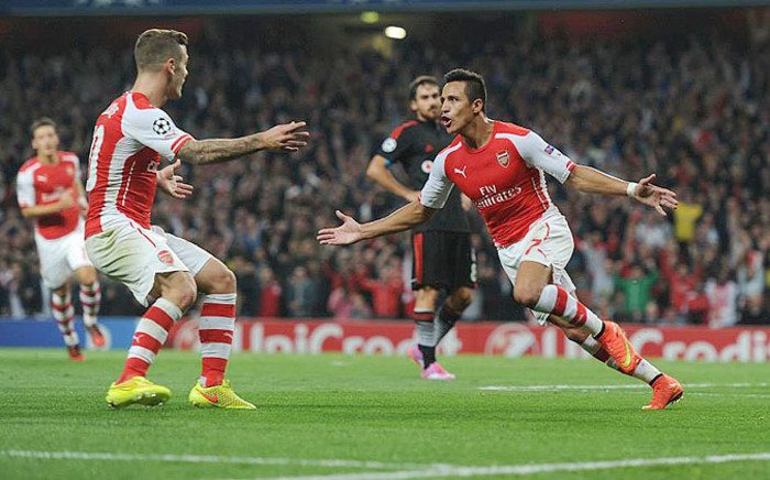 Arsenal's Alexis Sanchez celebrates after scoring a goal against Besiktas in the Champions League play-offs on 28 August 2014. Picture: Official Arsenal FC Facebook page