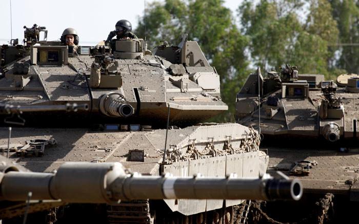 Israeli soldiers manoeuver Merkava tanks in the Israeli-annexed Golan Heights on 2 June 2019. Picture: AFP
