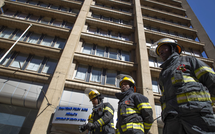 FILE: Firefighters stand in front of the Bank of Lisbon building where 3 of their colleagues died while trying to extinguish a fire. A memorial service was held for the firefighters on 12 September 2018. Picture: Christa Eybers/EWN.