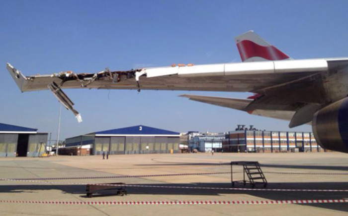 The British Airways Boeing 747 wing after it hit into a building at OR Tambo International Airport on 22 December 2013. Picture: iWitness.