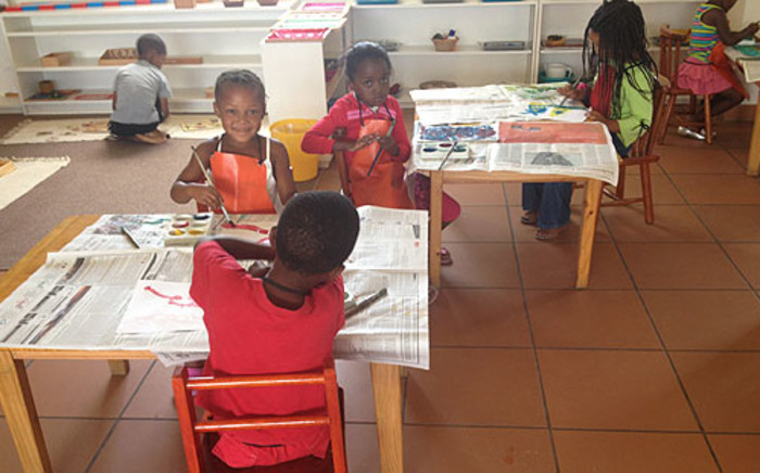 Children painting inside their classroom at Jo's School on 24 January 2013. Picture: Giovanna Gerbi/EWN